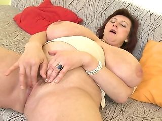 Jana P. Licks Her Enormous Breasts And Plays With Her Labia