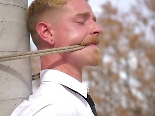 Homo Businessman Strapped To A Pole And Force Fed Prick Down His Jaws