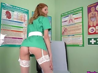 Crimson Haired Nurse Leah Flashes Her Natural Tits Pridefully At Work