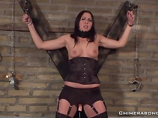 Dark-haired Sweetheart Gets Tied Up To The Playroom Wall