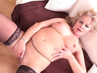 Milena V. Exposes Her Large Tits And Masturbates In Stockings
