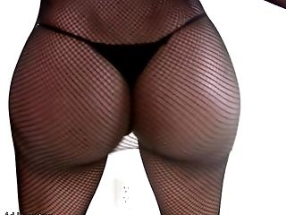 Black Tranny In Fishnet Is Wiggling And Frigging Massive Bum