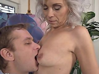 Flirtatious Greyhaired Cougar Kathy Meets Youthful Paramour